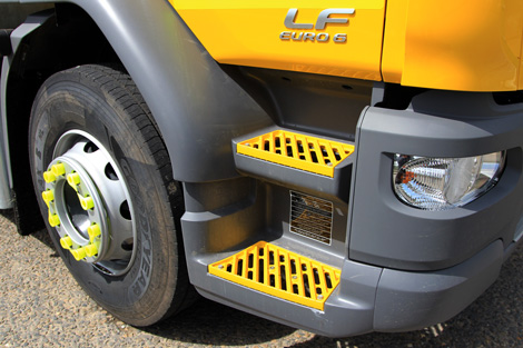 Powder coated yellow steps on a IPV cab